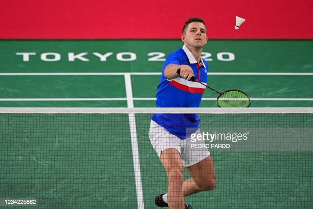 France's Brice Leverdez hits a shot to Ukraine's Artem Pochtarov in their men's singles badminton group stage match during the Tokyo 2020 Olympic...