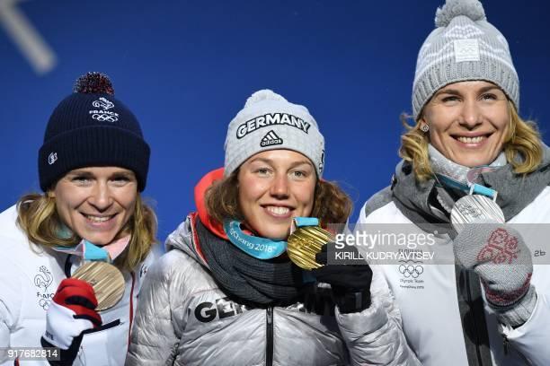 France's bronze medallist Anais Bescond, Germany's gold medallist Laura Dahlmeier and Slovakia's silver medallist Anastasiya Kuzmina pose on the...