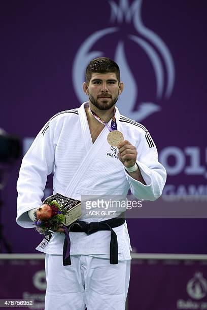 France's bronze medallist Cyrille Maret poses on the podium during the victory ceremony for the men's 100kg judo at the 2015 European Games in Baku...