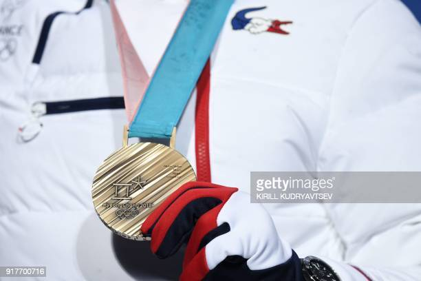 France's bronze medallist Victor MuffatJeandet poses on the podium during the medal ceremony for the Men's alpine skiing combined at the Pyeongchang...