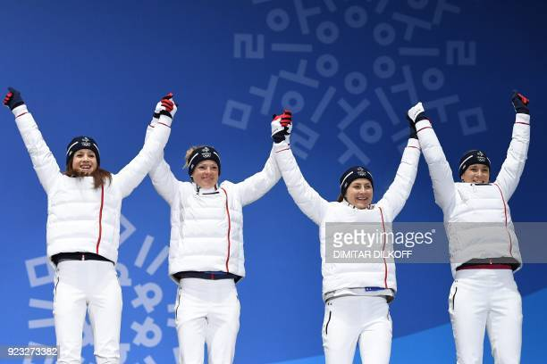 France's bronze medallists Anais Chevalier, Marie Dorin Habert, Justine Braisaz and Anais Bescond pose on the podium during the medal ceremony for...