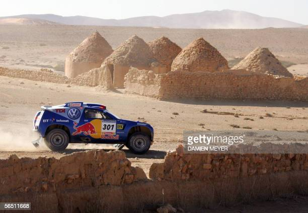 France's Bruno Saby drives 02 January 2006 during the second stage of the 28th Dakar rally between Nador and Er Rachidia France's JeanLouis Schlesser...