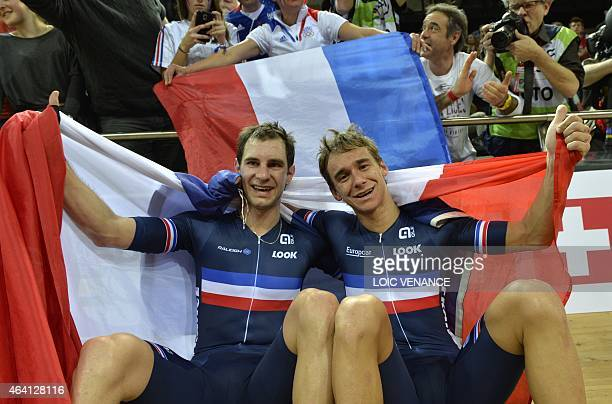 France's Bryan Coquard and his teammate Morgan Kneisky celebrate with a French flag after winning gold in the Men's Madison final at the UCI Track...