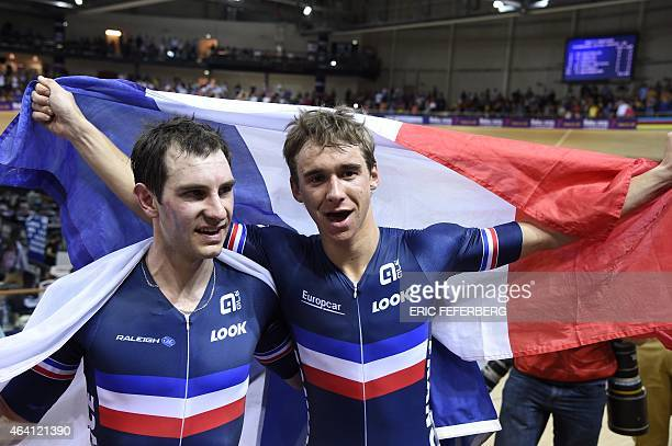France's Bryan Coquard and Morgan Kneisky celebrate with a French flag after coming in first in the Men's Madison final at the UCI Track Cycling...