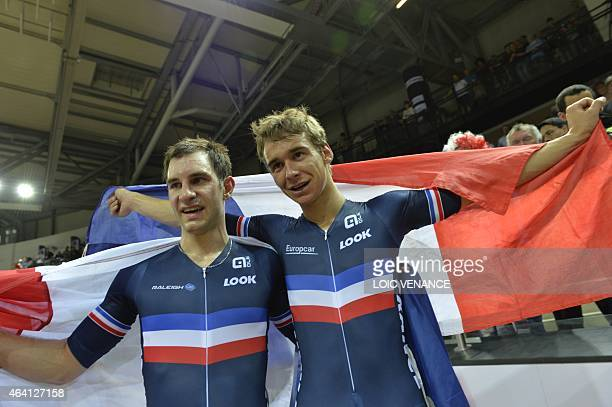 France's Bryan Coquard and Morgan Kneisky celebrate with a French flag after winning gold in the Men's Madison final at the UCI Track Cycling World...