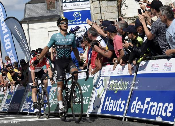 France's Bryan Coquard celebrates as he crosses the finish line to win the fourth stage of the Four days of Dunkirk cycling race on May 11 2018 in...