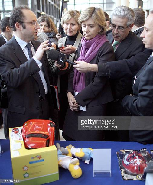 France's Budget Minister Valerie Pecresse speaks with Jerome Fournel , director general of Customs, before an exhibition of counterfeit goods, before...