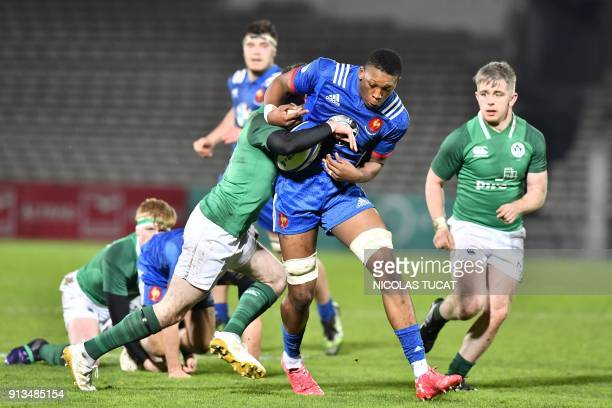 France's Cameron Woki runs with the ball during the Six Nations U20 rugby union match between France and Ireland at the ChabanDelmas Stadium in...