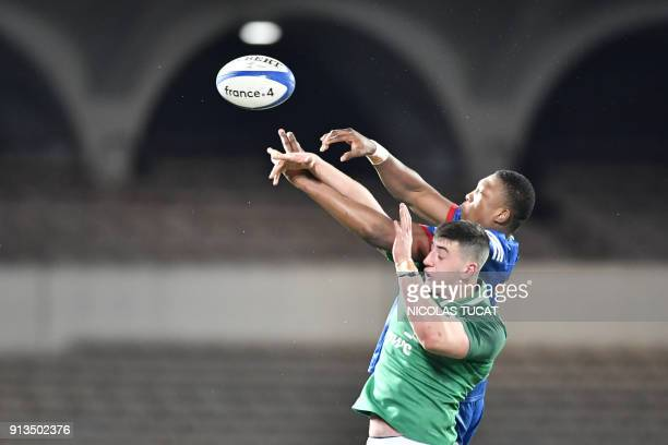 France's Cameron Woki vies for the ball with Ireland's Matthew Dalton during the Six Nations U20 rugby match France versus Ireland on February 2 2018...