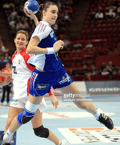France's Camille Ayglon tries to score in front of Hungary's Gabriella Szucs during the women world championship handball place 5 to 8 qualifying...