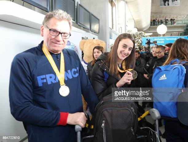 France's Camille AyglonSaurina and France's coach Olivier Krumbholz are pictured upon the team's arrival at Roissy airport the day after France won...