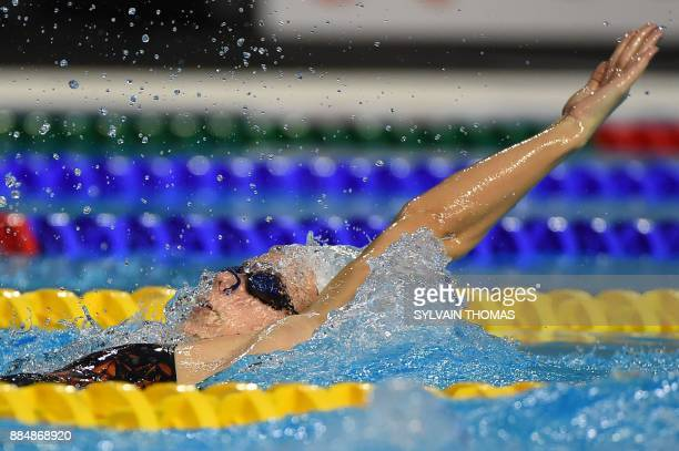 France's Camille Gheorghiu competes in the women's 200m backstroke final at the 25m French swimming championships in Montpellier on December 3 2017 /...