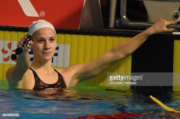 France's Camille Gheorghiu reacts after winning the women's 200m backstroke final at the 25m French swimming championships in Montpellier on December...