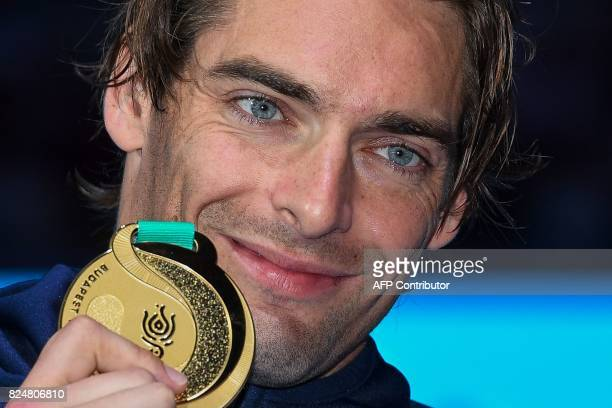 France's Camille Lacourt poses with his gold medal on the podium of the men's 50m backstroke during the swimming competition at the 2017 FINA World...