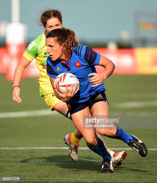 France's captain Fanny Horta caries the ball against Australia on the final day of HSBC World Rugby Women's Sevens Series in Langford BC Canda on...