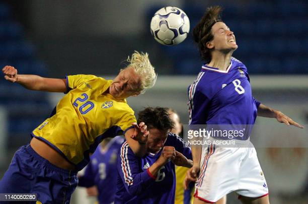 France's captain Laure Lepailleur vies with Sweden's Sonia Bompastor during their XII World feminin championship football match, Algarve Cup, for the...