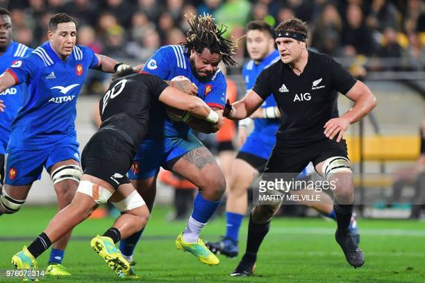 France's captain Mathieu Bastareaud is tackled by New Zealand's Ardie Savea and Luke Whitelock during the second rugby Test match between New Zealand...