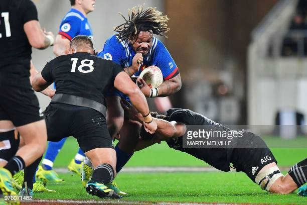 France's captain Mathieu Bastareaud is tackled by New Zealand's Ofa Tu'ungafasi and Luke Whitelock during the second rugby Test match between New...
