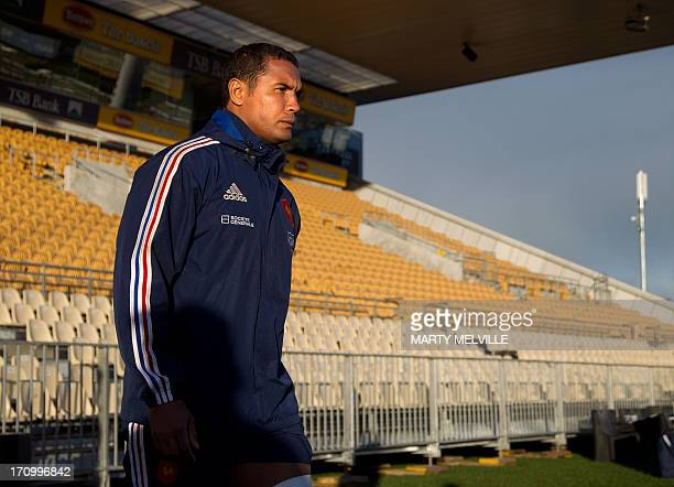 France's captain Thierry Dusautoir walks onto the field during the captain's run ahead of the third rugby union test mach against the New Zealand All...