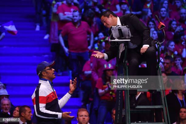 France's captain Yannick Noah agrues a call with the umpire during the singles rubber 4 of the Davis Cup World Group final tennis match between...