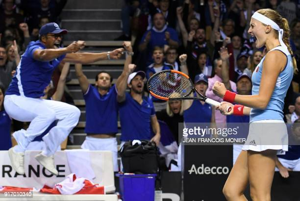 France's captain Yannick Noah and France's Kristina Mladenovic react after a point during the Fed Cup World group first round tennis double match...