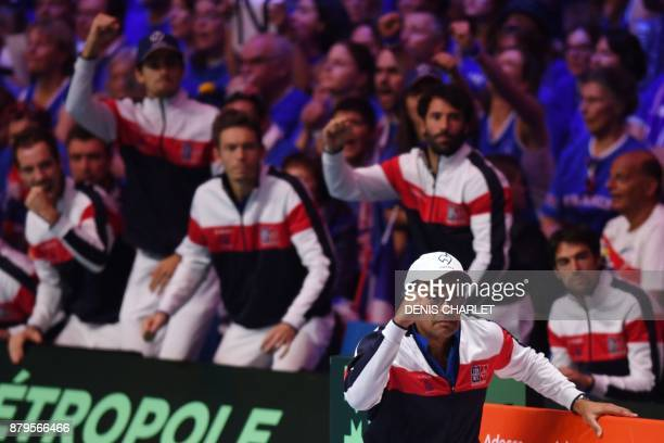 France's captain Yannick Noah and France's team members cheer during the singles rubber 5 match between Belgium's Steve Darcis and France's Lucas...
