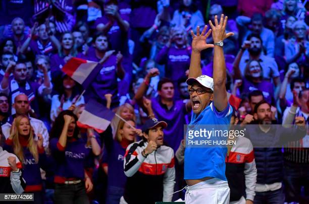 France's captain Yannick Noah cheers during the doubles tennis match at the Davis Cup World Group final between France and Belgium at Pierre Mauroy...