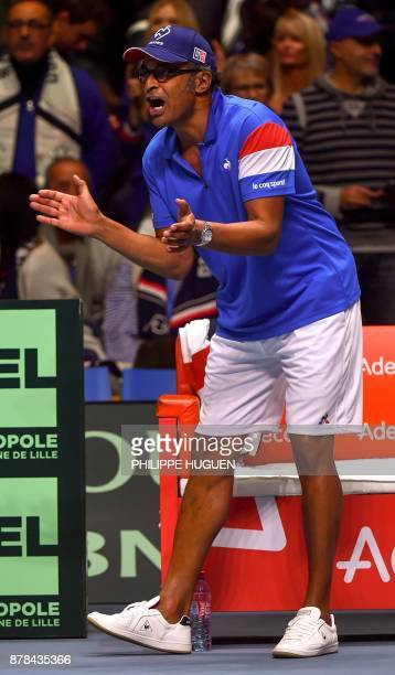 France's captain Yannick Noah cheers during the first Davis Cup World Group singles rubber final tennis match between France and Belgium at The...