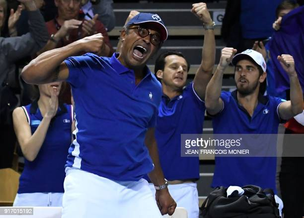 France's captain Yannick Noah reacts after France's Kristina Mladenovic and France's Amandine Hesse won against Belgium's Elise Mertens and Belgium's...