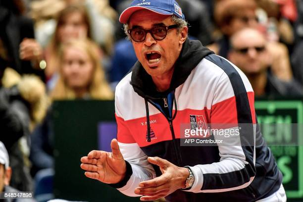 France's captain Yannick Noah reacts during the Davis Cup world group semifinal tennis match between France and Serbia at the Pierre Mauroy stadium...