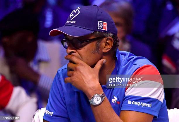 France's captain Yannick Noah reacts during the match between Belgium's David Goffin and France's Lucas Pouille at the Davis Cup World Group singles...