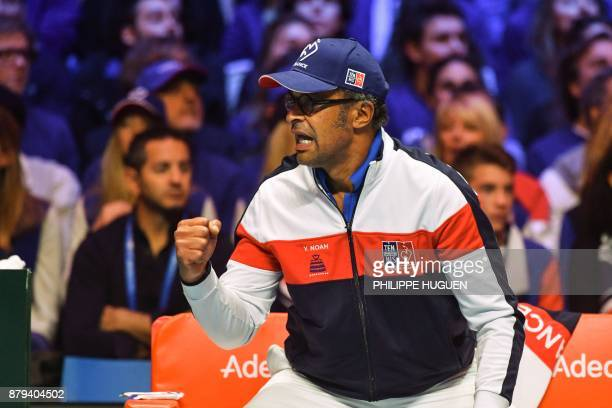 France's captain Yannick Noah reacts during the singles rubber 4 of the Davis Cup World Group final tennis match between France and Belgium at The...
