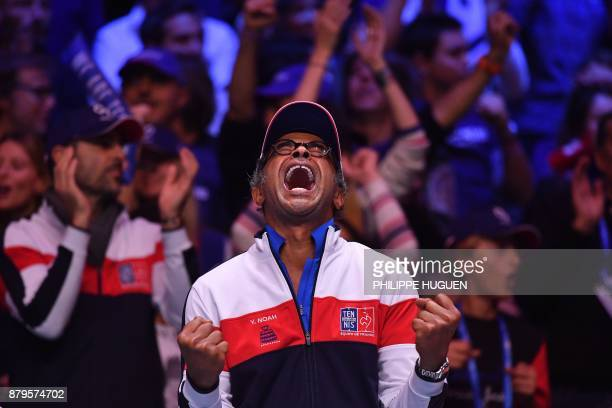 TOPSHOT France's captain Yannick Noah reacts during the singles rubber 5 match between Belgium's Steve Darcis and France's Lucas Pouille at the Davis...