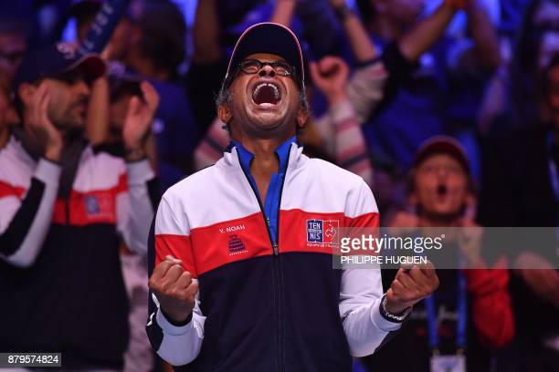 France's captain Yannick Noah reacts during the singles rubber 5 match between Belgium's Steve Darcis and France's Lucas Pouille at the Davis Cup...
