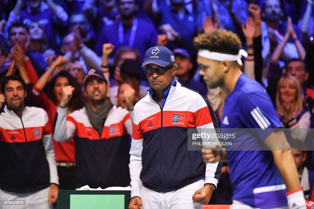 France's captain Yannick Noah (C) reacts next to France's Jo-Wilfried Tsonga (R) during the singles rubber 4 of the Davis Cup World Group final tennis match between France and Belgium at The Pierre Mauroy Stadium in Villeneuve d'Ascq near Lille on November 26, 2017. /