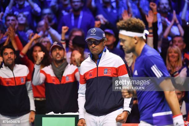 France's captain Yannick Noah reacts next to France's JoWilfried Tsonga during the singles rubber 4 of the Davis Cup World Group final tennis match...