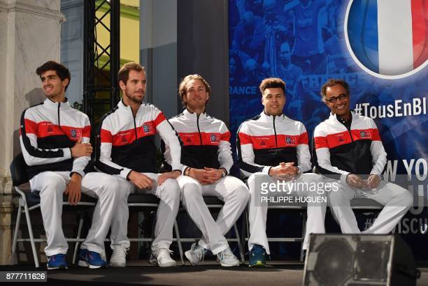 France's captain Yannick Noah sits next to his players PierreHugues Herbert Richard Gasquet Lucas Pouille and JoWilfried Tsonga during the team...