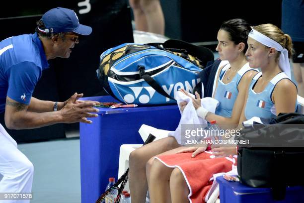 France's captain Yannick Noah talks to France's Amandine Hesse and France's Kristina Mladenovic during their double tennis match against Belgium's...