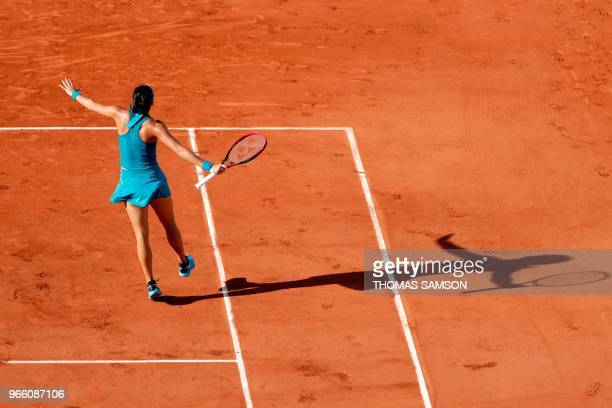 France's Caroline Garcia celebrates after victory against Romania's Irina-Camelia Begu in their women's singles third round match on day seven of The...