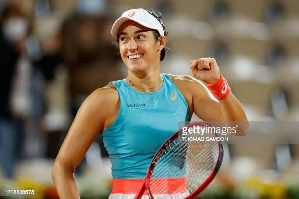 France's Caroline Garcia celebrates after winning against Belarus' Aliaksandra Sasnovich at the end of their women's singles second round tennis...