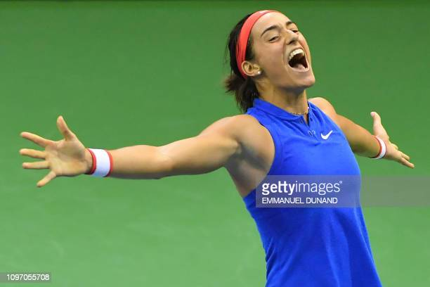 France's Caroline Garcia celebrates after winning against Belgium's Elise Mertens, at the end of the Fed Cup World Group first round quarter final...