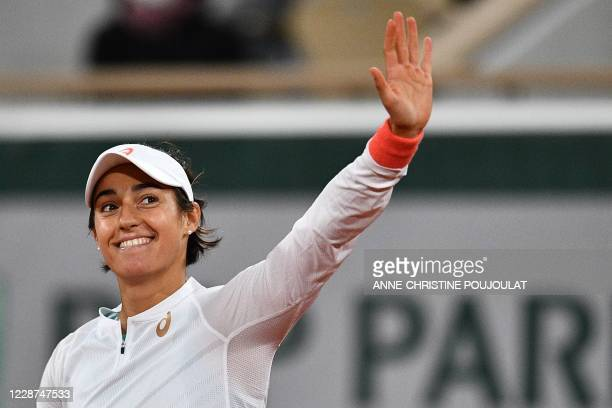 France's Caroline Garcia celebrates after winning against Estonia's Anett Kontaveit during their women's singles first round tennis match on Day 1 of...