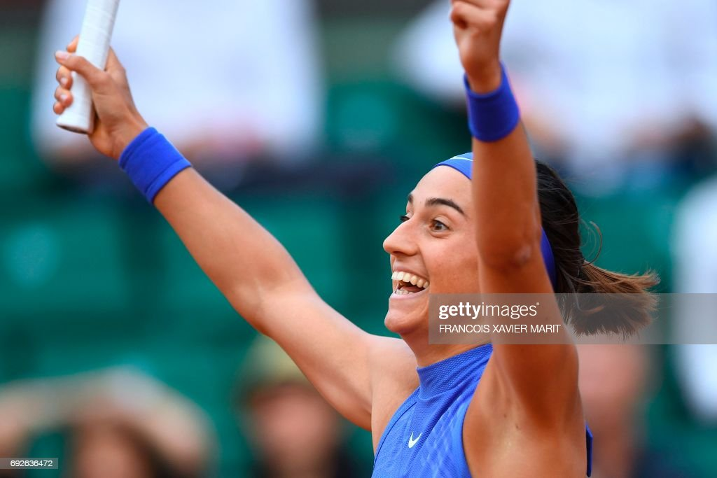 France's Caroline Garcia celebrates after winning against France's Alize Cornet during their tennis match at the Roland Garros 2017 French Open on June 5, 2017 in Paris. /