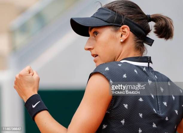 France's Caroline Garcia celebrates after winning against Germany's Mona Barthel at the end of their women's singles first round match on day three...