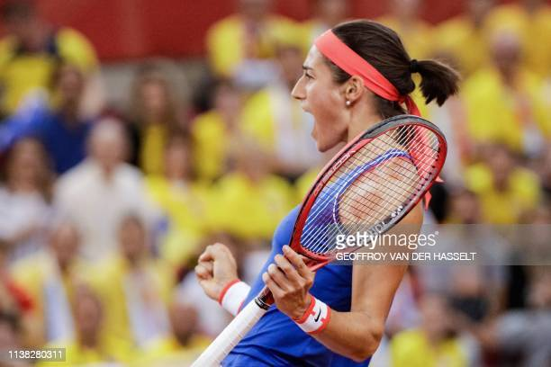 France's Caroline Garcia celebrates after winning against Romania's Mihaela Buzarnescu at the end of their second rubber of the Fed Cup tennis...