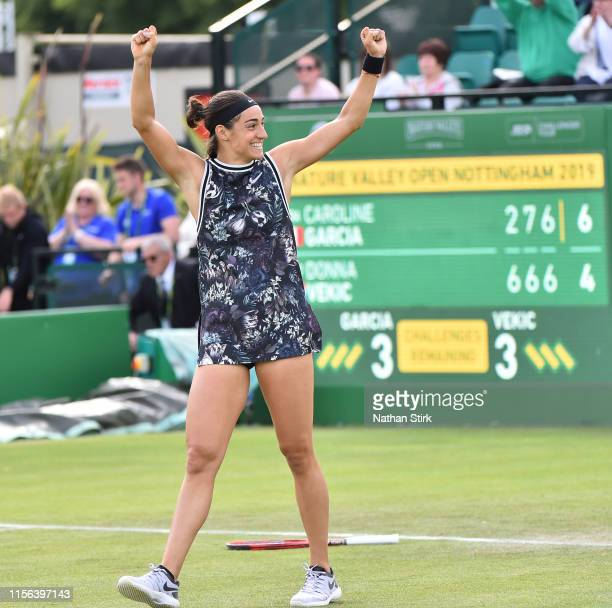 France's Caroline Garcia celebrates after winning the women's final against Croatia's Donna Vekic during day seven of the Nature Valley Open at...