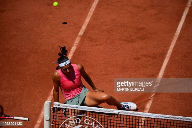 France's Caroline Garcia falls as she plays against Germany's Laura Siegemund during their women's singles first round tennis match on Day 2 of The...