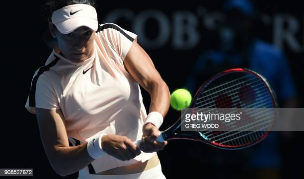 France's Caroline Garcia hits a return against Madison Keys of the US during their women's singles fourth round match on day eight of the Australian...