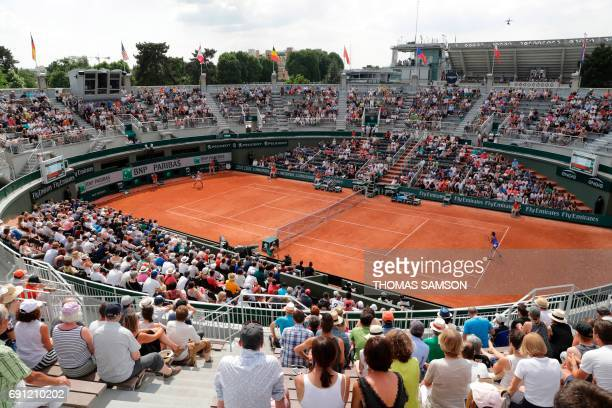 France's Caroline Garcia plays against France's Chloe Paquet during their tennis match at the Roland Garros 2017 French Open on June 1 2017 in Paris...