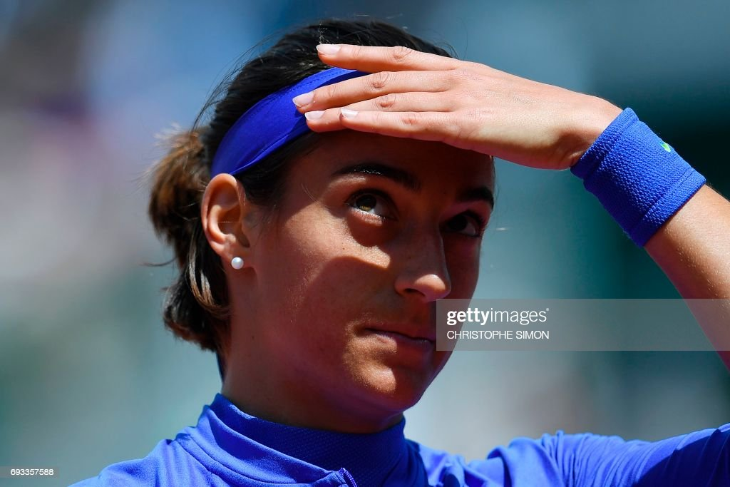 France's Caroline Garcia reacts after a point against Czech Republic's Karolina Pliskova during their tennis match at the Roland Garros 2017 French Open on June 7, 2017 in Paris. /